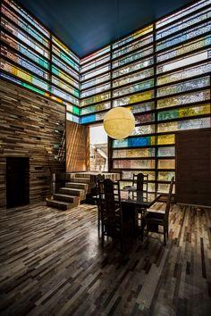 Beautiful light shining from a dining room window! 🌈 || Architect in Charge: MohammadReza Ghanee &  Ashkan Ghanee || Photographer: Farshid Nasr Abadi || Location: Iran_ Esfahan || #MemareMan #Architecture #Architect #Design #Designer #Interior_Design #Decoration #Home_Decor #Color #Colorful #colorful_glass #Art #Stair #Lighting #Furniture #Iran #Iranian_Architect #معمارمن #ایران #طراحان_ایرانی