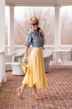 Classic with a touch of romance. Skirt is so pretty. I like the shoes and the bag as well. Not a big fan of jean top.