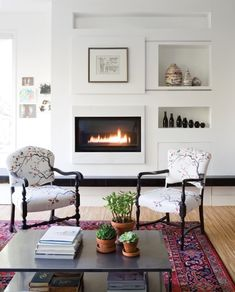Fireplaces. Love the wall with integrated fireplace. Possibly for reception room??