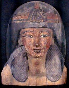 19th dynasty ancient Egyptian wooden mummy mask of a Noble man with the long twists hairstyle still worn today by Afar men of the Horn of Africa, Somalia, Djibouti, and without the need to use wigs. The Afar men cover the top of the hair with ghee (clarified butter), and let it melt in the sun to cool their scalp.