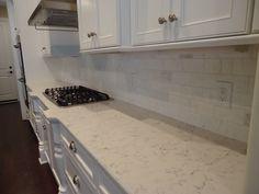 ARH Huntington Plan.  Custom Residence.  Silestone Lyra countertop and marble backsplash. (Kitchen 2)