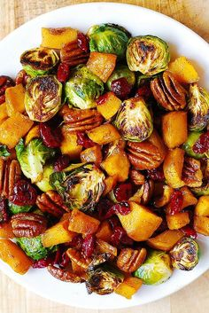 Roasted Brussels Sprouts, Cinnamon Butternut Squash, Pecans, and Cranberries – this easy Thanksgiving side dish is not only delicious and bursting with Fall and Holiday flavors (cinnamon, maple syrup), it's also healthy, gluten free, vegetarian, and packed with fiber!
