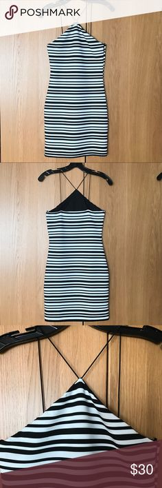 Topshop Strappy Triangle-Neck Bodycon Dress NWOT. A strappy triangle neckline adds shoulder-flattering charm to a body-con dress banded with jazzy black-and-white stripes! Partially lined. 96% polyester, 4% elastane. New without tags. Never worn. (Tags removed to take on a trip, but never worn.) Topshop Dresses Mini