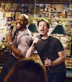 Sergeant Terry Jeffords and Detective Jake Peralta perform karaoke