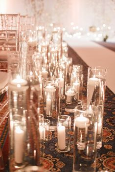 Floating candles along the aisle for a ballroom ceremony at Disney's Yacht & Beach Club