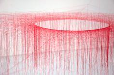 Red thread sculpture by Akiko Ikeuchi