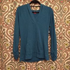 NWOT Puma Pullover BNWOT Puma lightweight hoodie pullover top!! Unbelievably soft material, adorable heathered blue color, NEVER WORN, BRAND NEW condition!!! Third picture shows color, fourth picture shows style of jacket. Size medium. Puma Tops Sweatshirts & Hoodies