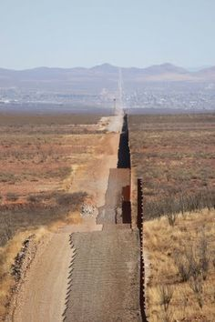 Border Fence looking towards Douglas, And we still can't keep them out. Here it is a case of DO FENCE THEM IN.