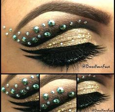 Jewels accent dramatic black and gold eye shadow.