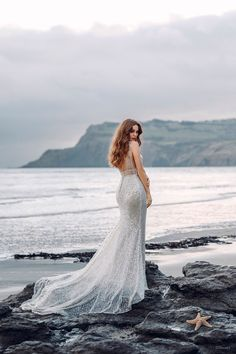This Ariel-inspired gown is playful, yet elegant. A subtle flared train is reminiscent of a mermaid's silhouette, while sparkling sequins mimic the play of light across the moonlit sea. Fit And Flare Wedding Dress, Wedding Dress Sizes, Dream Wedding Dresses, Boho Wedding Dress, Designer Wedding Dresses, Mermaid Wedding, Wedding Gowns, Disney Inspired Wedding Dresses, Ariel Dress