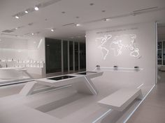 Sleek, minimalist bench-table design giving out futuristic appeal Spaceship Interior, Futuristic Interior, Futuristic Furniture, Futuristic Design, Interior Design Exhibition, Exhibition Space, Office Interior Design, Office Interiors, Display Design