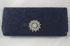 Hey, I found this really awesome Etsy listing at https://www.etsy.com/listing/185532887/navy-blue-clutch-purse-navy-blue-lace