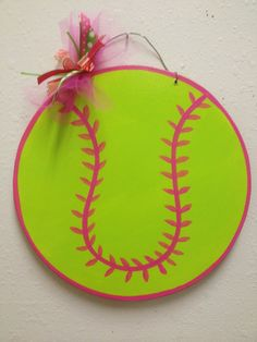 Softball that matches her room!  but maybe not the floral piece on top... maybe a ribbon with polka dots instead