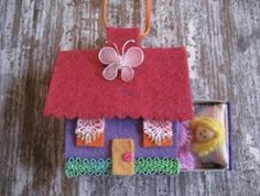 matchbox dollhouse, also a necklace, my gd loved it