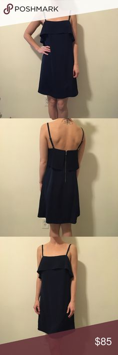 Alice + Olivia Navy Sleeveless Shift Dress Alice + Olivia dark navy Sleeveless dress with adjustable straps and a Ruffle top with a zipper closure in the back. Shift style and is super cute in a size small! Alice + Olivia Dresses Midi
