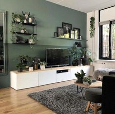 Woonkamer-met-witte-tvkast-en-groene-muur Living room with white TV cabinet and green wall Living Room Green, Living Room Tv, Home And Living, Apartment Living, Living Room Wall Colors, Tv Wall Ideas Living Room, Small Living, Living Room Accent Wall, Wall Cabinets Living Room