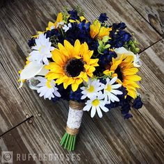 ***{PLEASE REFER TO OUR SHOPS ANNOUNCEMENTS FOR CURRENT PROCESSING TIME}*** THIS LISTINGS DETAILS This bridal bouquet is a perfect combination of beautiful artificial sunflowers, real touch white calla lilies, silk daisies and navy blooms with pops of wild greenery finished with a