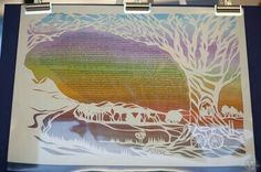 beautiful paper cut out with colorful background ketubah.