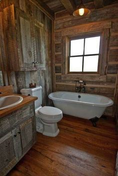 Design a stylish bathroom in your home with a rustic barn interior that creates a chic ambiance. I love rustic barn everything! Would it be to much to have an entire house of it? I should just live in a house design design room design home design Rustic Bathroom Designs, Bathroom Interior Design, Shower Designs, Modern Interior, Cabin Homes, Log Homes, Barn Bathroom, Bathroom Ideas, Bathtub Ideas