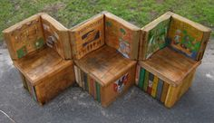 Oak book bench ~ A pupil at Clarkston Primary School in North Lanarkshire (Scotland) came up with the winning art project concept of a bench of books for their playground.