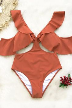 """Turn heads in our Orange Ruffled Cold Shoulder One-Piece Swimsuit. This bathing suit has a pretty ruffled neckline and ruffles at the arms for a """"cold shoulder"""" look. Strategically placed side cutouts give it flirty vibes and figure flattering appeal. Cute Swimsuits, Women Swimsuits, Bikini Swimwear, Bikini Tops, Strap Bikini, Striped One Piece, Cute Bathing Suits, Floral Bikini, One Piece Swimsuit"""
