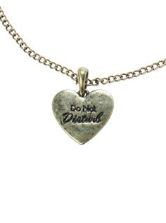 "Burnished gold tone necklace with a ""Do Not Disturb"" heart pendant."