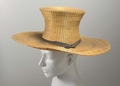 Large straw hat with high crown, black ribbon.