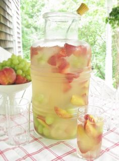 No fail cocktails for a crowd ~ Combine 1 bottle white wine, 3 cans of fresca, fresh fruit such as peaches, strawberries, grapes, etc. Serve in a lg vintage jar with a silver ladle... Its like sophisticated sangria without all the work.