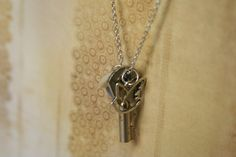 Key Charm Necklace - made with a small key and a bird charm. $21.00, via Etsy.