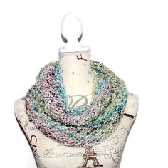 This light and airy circle scarf is luxuriously soft as well as beautiful and versatile. Hand knit with an easy care, multicolored, acrylic yarn in