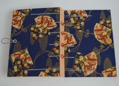 Caderno artesanal com capa revestida em tecido de algodão, costura belga secreta (criss cross), feito por Cláudia Ladeira, Trifolium Atelier.