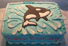 One of the girls I babysit requested a killer whale birthday cake. Orca and water splashes are royal icing transfers, shells are white choco...