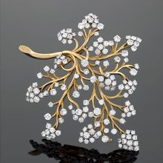 A French Mid 20th Century 18 karat gold and platinum brooch with diamonds by Van Cleef & Arpels. Circa 1960s