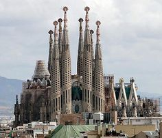 Sagrada Familia, a basilica in Barcelona, Spain. Designed by Antoni Gaudi. Has  been under construction for 128 years. Was consecrated as a basilica by Pope Benedict in 2010. It was the first Mass ever celebrated there. An 800 member choir sang.