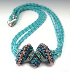 Cellini pendant, strung on a six-strand necklace from Jill Wiseman   ~ Seed Bead Tutorials