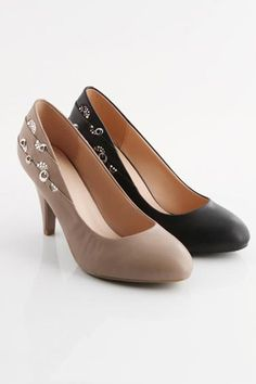 Court shoes crafted in PU, featuring a leather look finish, pointed toe, a low cut vamp with rhinestone and metal ring detail, a treaded rubber sole with a tapered high heel.