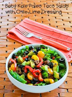 Recipe for Baby Kale Paleo Taco Salad with Chile-Lime Dressing; this salad is delicious whether or not you eat Paleo!  [from Kalyn's Kitchen] #LowCarbRecipes  #PaleoRecipes  #LowGlycemicRecipes