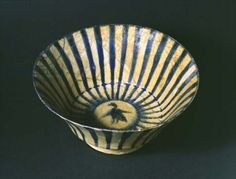 Bowl with blue stripes and a bird in centre, Kashan, Iran, 13th century (pottery)