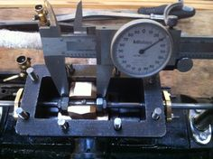 Fitting the slide valve . The callipers are use to show the scale