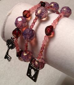 Lock and key bracelet made from Czech Firepolish glass beads on Etsy, $22.00