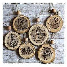 Wood Burned Christmas Ornaments. Cut wood slices, stamp w/rubber stamps. Use wood burning tool to burn images.
