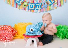pom poms, blue monster, eating cake, Newport Beach, Monster smash cake, 1st birthday, baby boy, Orange County photographer, birthday cake smash, first birthday cake, portait session, Blue, French's cupcake bakery, monster theme, GilmoreStudios.com