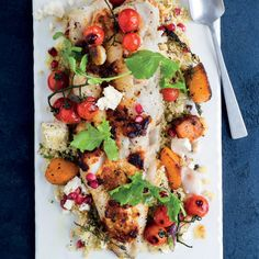 Hake with herby butternut and couscous-and-feta salad