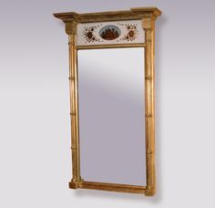 A fine Early 19th Century Regency period carved giltwood Pier glass having moulded cornice above verre eglomisee panel, the mirror plate flanked by carved cluster columns. Circa: 1810 Ref: 3898