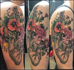 Anatomical heart and flowers by Hueso Gibink tattoos Gibraltar.