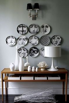 Fornasetti Plates. - I love this. But maybe still a good example of the rich bourgeoisie want to go a little crazy Boho. But what do I know, wretched man from a small town, close to nowhere? /uFFE