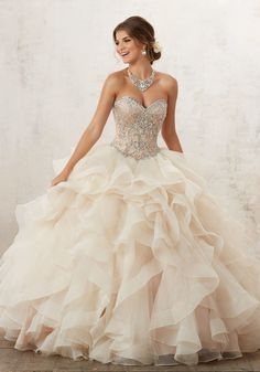 Classic Quinceañera Ballgown Combines a Stunning Jewel Beaded Sweetheart Bodice, and Full Ruffled Skirt Accented with Delicate Beading. Corset Back. Matching Bolero Jacket