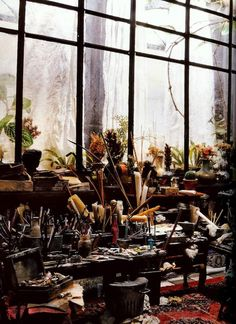 Miniature by French artist Ronan-Jim Sevellec who creates beautifully bohemian small worlds. At 80 years of age, his most recent exposition was in 2012, and saw his boxes of tiny artist's workshops and old antique rooms displayed in various eccentric and romantic locations around Paris