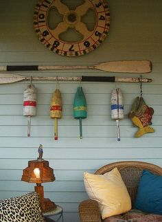 Cute display of Old buoy's & Oars Beach. For more ideas go nautical at Completely Coastal here: http://www.completely-coastal.com/search/label/Nautical%20Decor%20Ideas