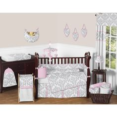 This elegant nine-piece crib bedding set will surround your baby in comfort and style. All the pieces in this darling set feature a gray damask pattern and pink trim, including a blanket, two valences, a fitted crib sheet, crib skirt, and more.